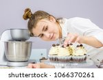 young happy woman decorates... | Shutterstock . vector #1066370261