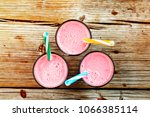 glasses of pink strawberry... | Shutterstock . vector #1066385114