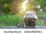 coins in jar on nature...   Shutterstock . vector #1066400561