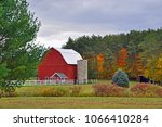 a red barn with a roofless... | Shutterstock . vector #1066410284