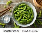 fresh steamed edamame sprinkled ... | Shutterstock . vector #1066413857