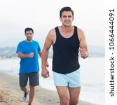 adult men are jogging together... | Shutterstock . vector #1066444091