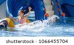 Girl Sliding In Pool During...