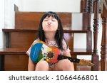 happy funny little asian girl...   Shutterstock . vector #1066466801