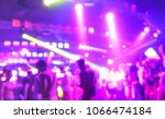 blurred people dancing at music ... | Shutterstock . vector #1066474184