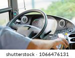 hands of driver in a modern bus ... | Shutterstock . vector #1066476131
