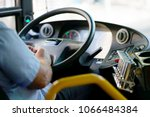 Hands Of Driver In A Modern Bu...