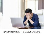 stressed out asian man... | Shutterstock . vector #1066509191