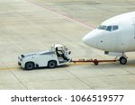 pushback tractor with aircraft... | Shutterstock . vector #1066519577