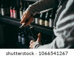 opening a wine bottle. | Shutterstock . vector #1066541267