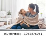 a nice girl and her mother... | Shutterstock . vector #1066576061