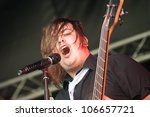 YATELEY, UK - JUNE 30: Carl Dawkins, bassist with British rock band The Chilli Fighters performing at the GOTG Festival in Yateley, UK on June 30, 2012 - stock photo