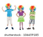 Happy kids with clown wigs standing in row - isolated - stock photo