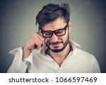 closeup portrait of an crying... | Shutterstock . vector #1066597469