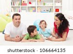 Young happy family playing together in the kids room - stock photo