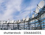 Small photo of Satellite antennas installed in a circle on the iron fittings. TV station with a lot of receiving devices. Telecommunication equipment of the telecentre