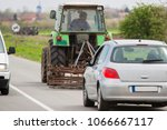 tractor on the road | Shutterstock . vector #1066667117
