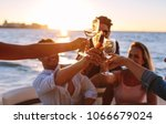 sunset boat party with young... | Shutterstock . vector #1066679024