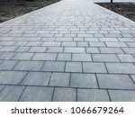 stone pavement in perspective....   Shutterstock . vector #1066679264