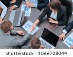 handshake financial partners at ... | Shutterstock . vector #1066728044