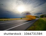 motion blurred yellow bus... | Shutterstock . vector #1066731584