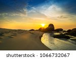 Small photo of Great and amazing sunset moment at Kerachut beach, National Park Pulau Pinang with beautiful sand texture. Malaysia. Long exposure.