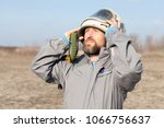 downed pilot waiting for rescue ... | Shutterstock . vector #1066756637