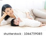 portrait of asian mother and... | Shutterstock . vector #1066759085