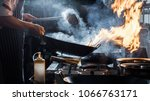 chef is stirring vegetables in... | Shutterstock . vector #1066763171