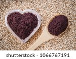 acai powder in bowl on wooden... | Shutterstock . vector #1066767191