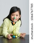 asian children play with straws.... | Shutterstock . vector #1066767785