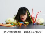 asian children play with straws.... | Shutterstock . vector #1066767809