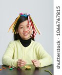 asian children play with straws.... | Shutterstock . vector #1066767815