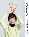 asian children play with straws.... | Shutterstock . vector #1066767845