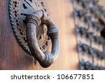Old Metal Knocker On A Door...