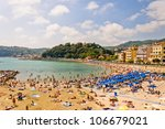 LERICI, ITALY - JUNE 2012: Tourists relax on the famous Venere Azzurra Beach on June 03, 2012 in Lerici, Italy. - stock photo