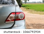 Stock photo the car s tail lights in the field 1066792934