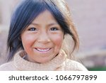 pretty little latin girl... | Shutterstock . vector #1066797899