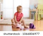 cute baby girl toddler sitting...   Shutterstock . vector #1066806977