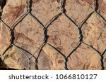 stone in a metal grid. texture. ... | Shutterstock . vector #1066810127