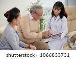 smiling doctor showing medical... | Shutterstock . vector #1066833731