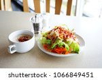 salad and crispy bacon in white ... | Shutterstock . vector #1066849451