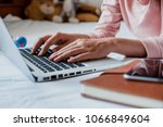 woman hands typing on keyboard... | Shutterstock . vector #1066849604