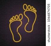 footprint neon light glowing... | Shutterstock .eps vector #1066874705