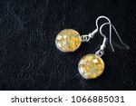 resin earrings with yellow... | Shutterstock . vector #1066885031