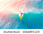 Surfer On A Yellow Surfboard In ...