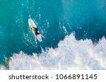 surfer in the ocean  top view | Shutterstock . vector #1066891145