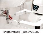 autonomous service robot is... | Shutterstock . vector #1066928687