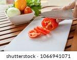 chef preparing vegetable for... | Shutterstock . vector #1066941071