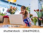 happy florist using... | Shutterstock . vector #1066942811
